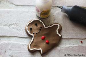 Step nine is to decorate your gingerbread man and insert into the mug topper.