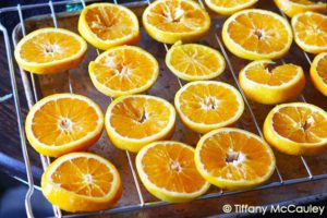 Place orange slices on oven rack with a pan under to catch the juices.