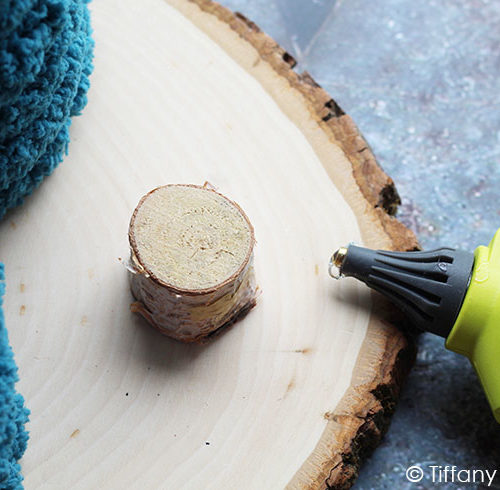 Add glue to one of the wood pieces.