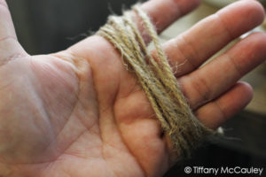 Wrap twine around your hand to make tassles.