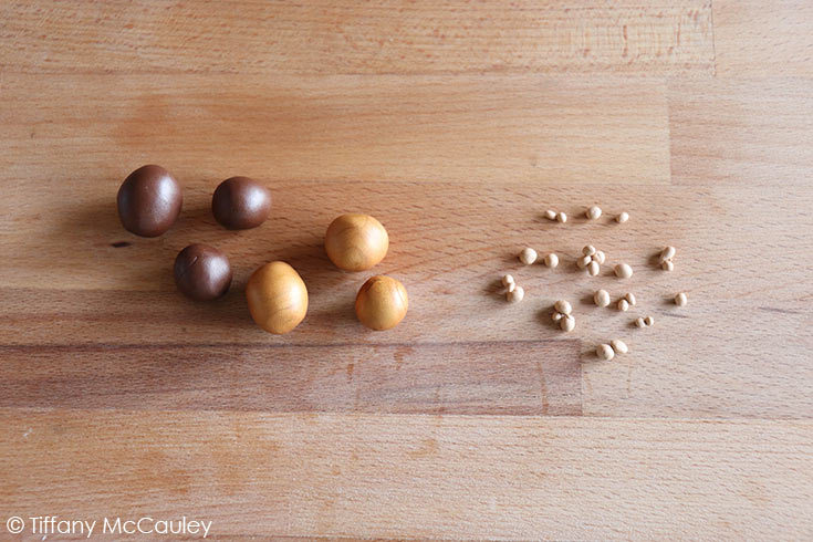 The brown clay for these polymer clay mushrooms, rolled into balls for caps and cap dots.