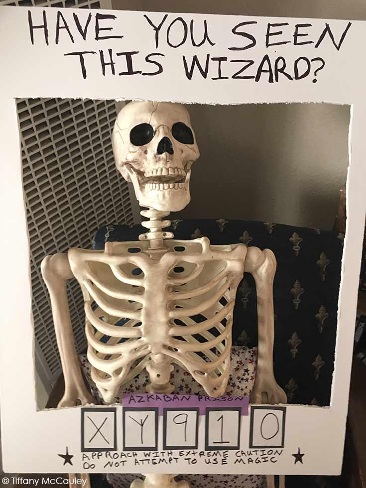 A skeleton behind a photo frame.