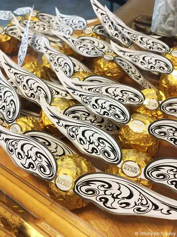 Candy golden snitches on a gold tray.